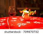 glass of red wine on red table... | Shutterstock . vector #709870732