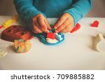 child playing with clay molding ...   Shutterstock . vector #709885882