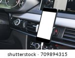 smartphone in a car use for... | Shutterstock . vector #709894315