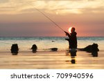angler fishing at the sea | Shutterstock . vector #709940596