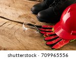 safety gear kit over wooden... | Shutterstock . vector #709965556