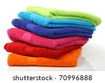 colorful stacked bathroom towels on a white background - stock photo
