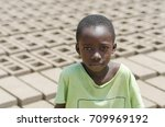 black child sitting outdoors as ... | Shutterstock . vector #709969192