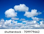 blue sky with clouds closeup | Shutterstock . vector #709979662