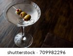 classic dry martini with olives.... | Shutterstock . vector #709982296