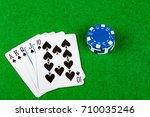 Poker hand Royal Flush Spades With Betting Chips - stock photo