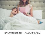a young mother is sitting in... | Shutterstock . vector #710054782