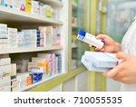 pharmacist holding medicine box ... | Shutterstock . vector #710055535