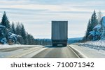 truck on the road at winter... | Shutterstock . vector #710071342