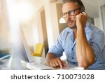 home office businessman talking ... | Shutterstock . vector #710073028