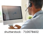 businessman working from home ... | Shutterstock . vector #710078602