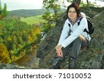 young girl on high rock - stock photo