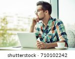 man is doing his freelance job... | Shutterstock . vector #710102242