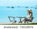 women wear hat sitting on... | Shutterstock . vector #710128576
