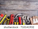 set of tools on wooden... | Shutterstock . vector #710141932