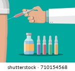 doctor hand with syringe making ... | Shutterstock .eps vector #710154568