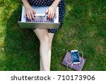 woman laptop sit grass | Shutterstock . vector #710173906