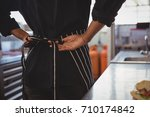 mid section of waitress wearing ... | Shutterstock . vector #710174842