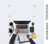 Small photo of Office workplace with laptop, notebook, hand, office supplies, on white background. Solution, business planning, financial analysis, accounting, start up or working flat lay top view concept.