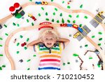 kids play with toy train... | Shutterstock . vector #710210452