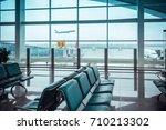 airport  terminal window view... | Shutterstock . vector #710213302