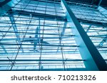 Small photo of upward view of airport terminal, airplane and glass building with blue tone