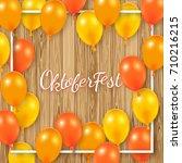 oktoberfest poster with shiny... | Shutterstock .eps vector #710216215