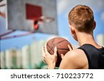 male playing basketball outdoor | Shutterstock . vector #710223772