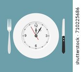 dinner time. cutlery. clock....   Shutterstock .eps vector #710225686