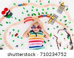 kids play with toy train... | Shutterstock . vector #710234752
