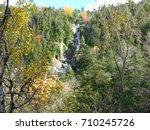 Small photo of A waterfall cascades through the Adirondack Mountains.
