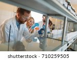 young students of chemistry... | Shutterstock . vector #710259505