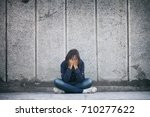 a teenage girl with depression... | Shutterstock . vector #710277622