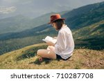 Young Girl In Hat Reading A...