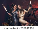 two beautiful girl in confetti... | Shutterstock . vector #710312452