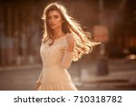 beautiful young lady with long... | Shutterstock . vector #710318782
