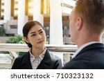 the secretary is curious to ask ... | Shutterstock . vector #710323132