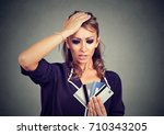 confused stressed woman looking ... | Shutterstock . vector #710343205