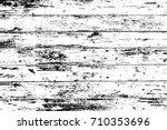 grunge wood overlay texture.... | Shutterstock .eps vector #710353696