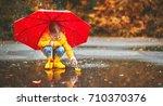 Happy Child Girl With Umbrella...
