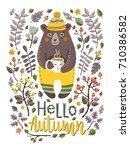 lovely autumn card with a bear  ...   Shutterstock .eps vector #710386582