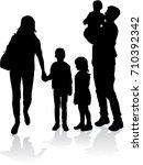 vector silhouette of family. | Shutterstock .eps vector #710392342