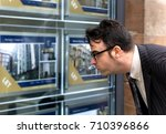 a business man looking at... | Shutterstock . vector #710396866