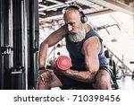 serious senior male is enjoying ... | Shutterstock . vector #710398456