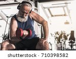 confident old pensioner is... | Shutterstock . vector #710398582