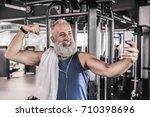 joyful senior male making... | Shutterstock . vector #710398696
