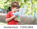 little boy playing with soap... | Shutterstock . vector #710411806