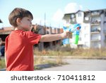 little boy playing with soap... | Shutterstock . vector #710411812
