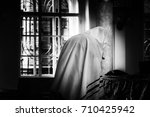 a jew praying in a synagogue | Shutterstock . vector #710425942