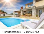 holiday house with pool | Shutterstock . vector #710428765